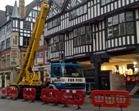 Cherry Picker fenced off outside of a tudor styled building.
