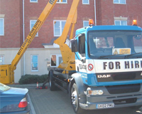 Cherry Picker preparing for work outside a set of flats.